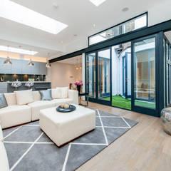 Basement Flat Refurb:  Living room by Balance Property Ltd