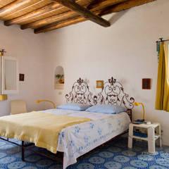 Mediterranean villa, Panarea, Aeolian Islands, Sicily:  Bedroom by Adam Butler Photography