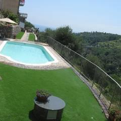 Piscinas de estilo  por italiagiardini,