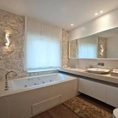 Baños de estilo  por Francesca Ignani Interiors