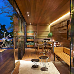 Living room by Cristina Menezes Arquitetura