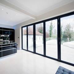 Kitchen Development with Bi Folding Doors:  Windows  by ROCOCO