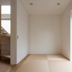 コンパクトで可愛いショートケーキハウス: M設計工房が手掛けた寝室です。