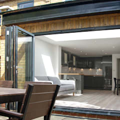 Sliding doors by GK Architects Ltd,