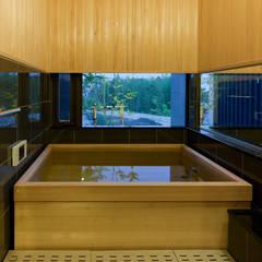 終の棲家: Egawa Architectural Studioが手掛けた浴室です。