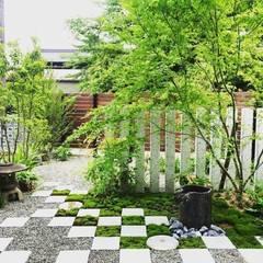 大口の庭: LIVING DESIGNが手掛けた庭です。