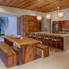 tropical Dining room by Specht Architects