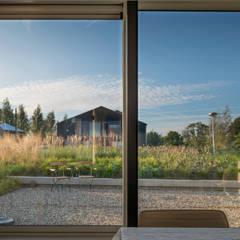 Tuin met verdiept terras: moderne Tuin door Architect2GO