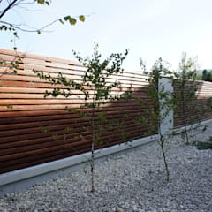 Ogrodzenie z betonu architektonicznego: styl , w kategorii Ogród zaprojektowany przez Contractors,