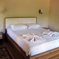 Cıralı Beach Bungalows – Çıralı Beach Bungalows: akdeniz tarzı tarz Yatak Odası