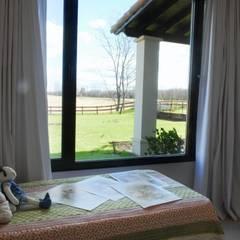 Vista desde DORMITORIO: Dormitorios de estilo  por Parrado Arquitectura