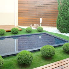 Residenciais: Casas  por Roncato Paisagismo e Comércio de Plantas Ltda