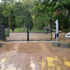Automatic remote controlled steel gates:  Garage/shed by AGD Systems