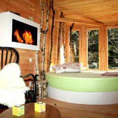 Cabaña Txantxangorria: Hoteles de estilo  de Cabañas en los árboles