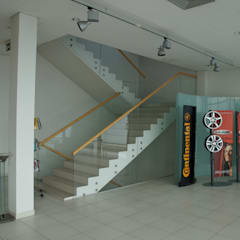 Frameless Glass Balustrade with wooden handrail:  Car Dealerships by Inox City Ltd