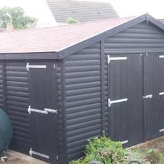 Bespoke Wooden Garge:  Garage/shed by Regency Timber Buildings LTD