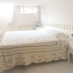 verbouwing appartement met grote kelder:  Slaapkamer door BALD architecture,
