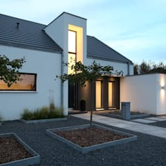 Houses by Architektur Jansen,