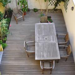 loft a milano: Terrazza in stile  di archiexpress
