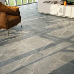 Cementos y metales en azulejos y pavimentos: Paredes de estilo  de INTERAZULEJO