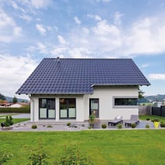 Casas prefabricadas de estilo  por FingerHaus GmbH - Bauunternehmen in Frankenberg (Eder), Moderno