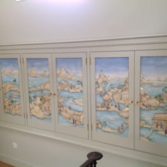 Handpainted panels incorporated into cupboard doors:  Corridor & hallway by Eades Bespoke