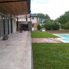 PROYECTO LANFRANCO: Jardines de estilo  por Baltera Arquitectura