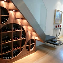 Wine cellar beneath contemporary staircase:  Wine cellar by Space Alchemy Ltd