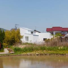 Casas de estilo  por 株式会社 T.N.A, Moderno