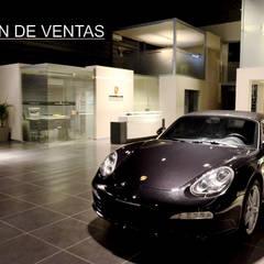 Oficinas Porsche: Concesionarios de estilo  por Postigo design