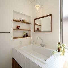 ランドマークになる家 / zuiun: zuiun建築設計事務所 / 株式会社 ZUIUNが手掛けた浴室です。
