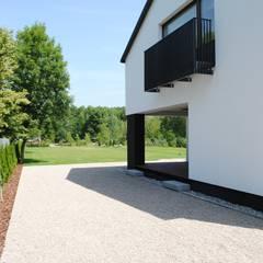 Widok na Kampinos: styl , w kategorii Domy zaprojektowany przez MITARCHITEKCI