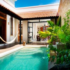 Garden by Taller Estilo Arquitectura, Eclectic