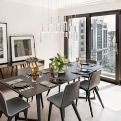 Roman House Penthouse:  Dining room by The Manser Practice Architects + Designers