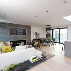 Roman House Penthouse:  Living room by The Manser Practice Architects + Designers