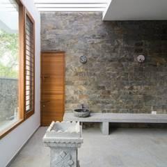 اتاق نشیمن توسطMuraliarchitects, مدرن