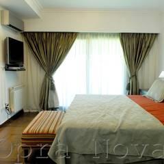 Suite: Dormitorios de estilo  por Opra Nova