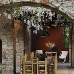 Chalet Atamisque Jardines de invierno rústicos de Bórmida & Yanzón arquitectos Rústico