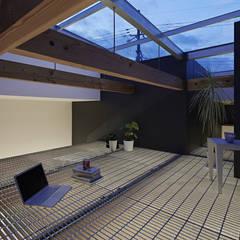 生駒の家: 安部秀司建築設計事務所が手掛けたサンルームです。