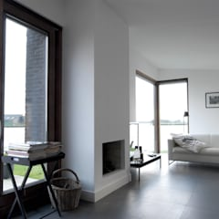 De woonkamer: minimalistische Woonkamer door Vos   Hoffer   vdHaar architecten