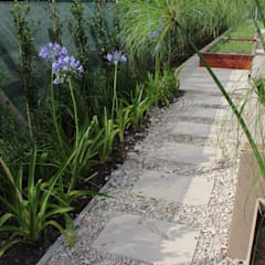caminos entre verde: Jardines de estilo  por BAIRES GREEN