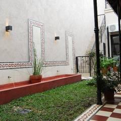 PATIO después : Jardines de estilo  por Parrado Arquitectura