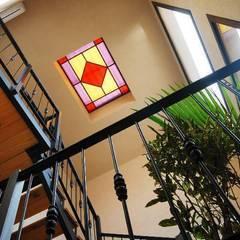 Reciclaje en Colegiales: Pasillos y recibidores de estilo  por Parrado Arquitectura