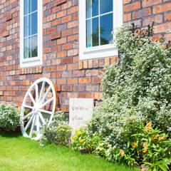 お洒落で可愛いレンガのお家: 株式会社 盛匠が手掛けた庭です。,オリジナル