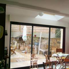 Réaménagement extension d'une longère Normande: Salle à manger de style de stile Rural par Frederic Mauret