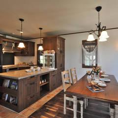 クラシカルで吹き抜けのある大きなお家: 株式会社 盛匠が手掛けたキッチンです。,クラシック