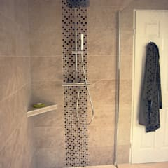 Baños de estilo  por BAOM