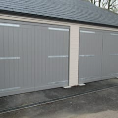 Painted Swing Electric Garage doors: modern Garage/shed by Portcullis Electric Gates