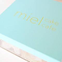 mielのためのパッケージデザイン.: 宮城雅子建築設計事務所 miyagi masako architect design office , kodomocafe が手掛けたオフィススペース&店です。
