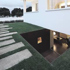 Casa José Prata: Jardins  por Barbosa & Guimarães, Lda.,Moderno